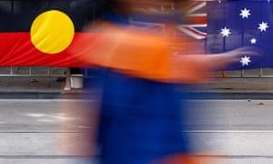 An Aboriginal (Indigenous Australian) and an Australian flag