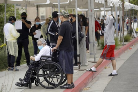 People line up at a mobile coronavirus testing site in Los Angeles.