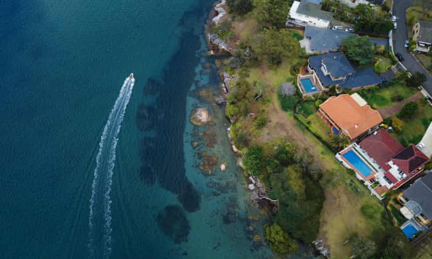 An aerial view of beachside mansions in Australia