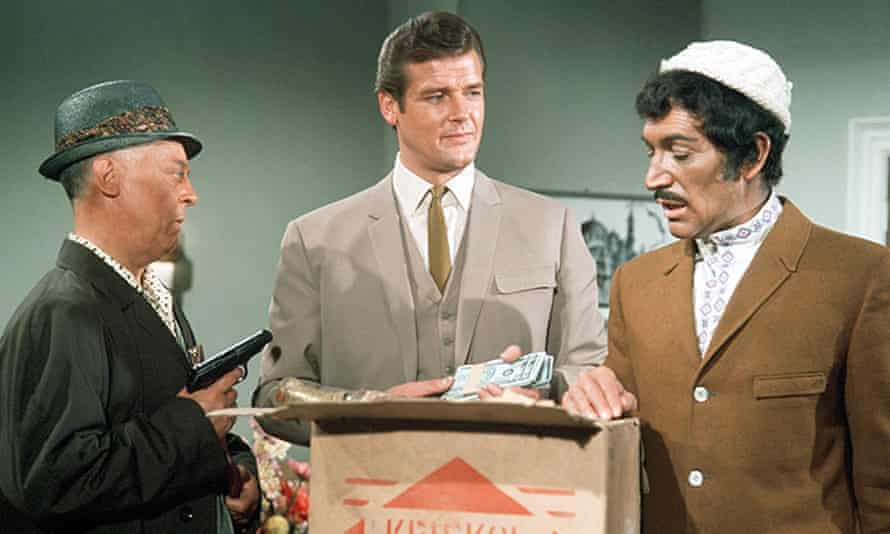Peter Wyngarde (to the right of Roger Moore) in the The Saint, 1967.