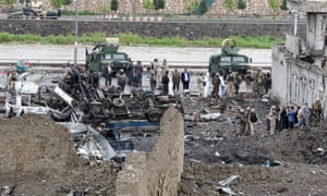 Afghan security officials at the site of the Kabul blast.
