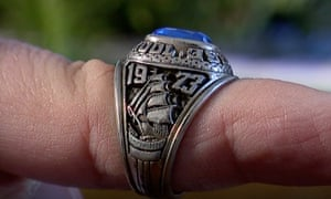 Debra Mckenna puts on her late husband's 1973 Morse high school class ring.