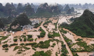 Submerged streets and buildings after heavy rain caused flooding in Yangshuo
