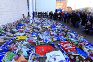 Mourners gather at the ground.