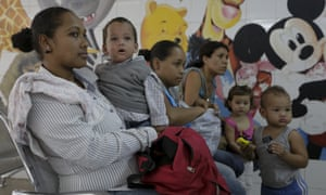 A woman who suspects her child to be infected with Zika virus, waits at an emergency room in a Caracas.