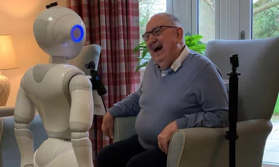 One of the robots with a care home resident