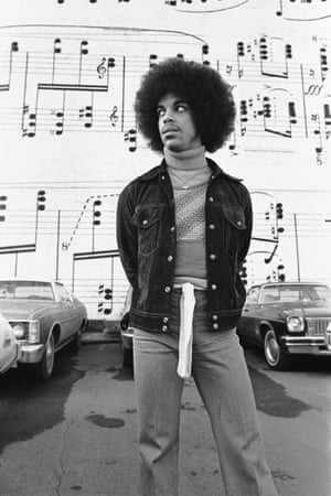 'The Music Wall – this is a famous place in Minneapolis. This is one of the few photos when I was on the ground, laying down and trying to make the photograph more formal with no eye contact. He looks a bit puzzled but I was quite funny in that position'