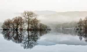 A thin dawn mist over Loch Lomond. Viewed from Balmaha on the east shore of the loch.