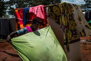 In the Nduta camp, Nahayo Vestine, 18, a Burundian refugee, folds washing she had hung out to dry