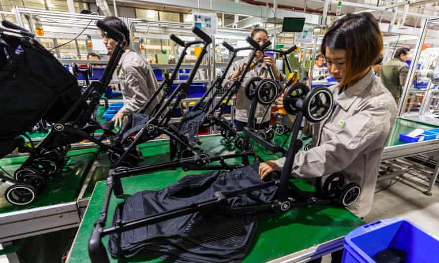 Workers assemble prams at the Good Baby factory in Kunshan city in Jiangsu province, China.