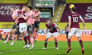 Burnley's Ben Mee scores their first goal.