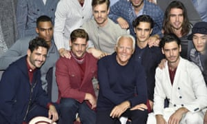 Giorgio Armani and models at the end of the men's collection.