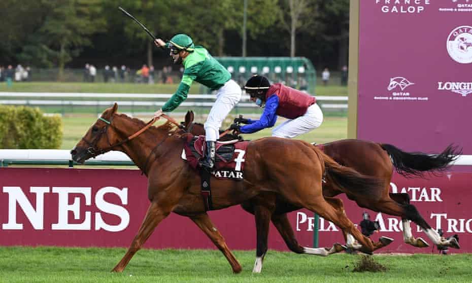 Jockey Cristian Demuro riding Sottsass crosses the finish line to win the Arc de Triomphe.