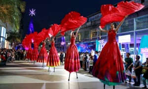 Artists perform on stilts at a New Year festival in Bangkok, Thailand.