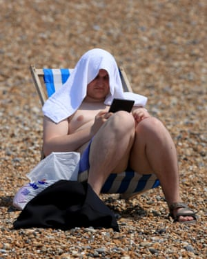 Sunbathing at Brighton beach.