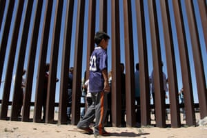 A boy from the Anapra area observes binational prayers at the border wall between Ciudad Juarez and Sunland Park, New Mexico.