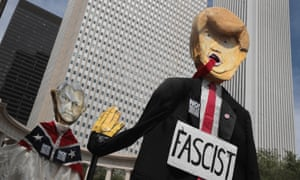 Puppets of Donald Trump and Jeff Sessions at a protest in Chicago at the weekend.