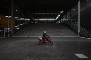 A food delivery rider rides past a deserted Southern Cross station in Melbourne.