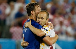 Ivan Rakitic hugs Barcelona team-mate Andres Iniesta at the end of the game.