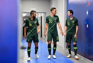 Aziz Behich, Trent Sainsbury, and Robbie Kruse walk through the tunnel at half-time.