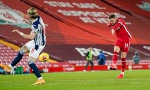 Liverpool midfielder Jordan Henderson takes a shot.