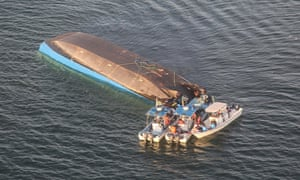 An aerial image shows the capsized ferry MV Nyerere
