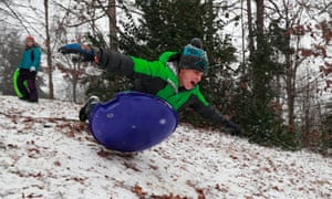James Young, 12, sleds down a hill during a winter storm in Charlotte, North Carolina Saturday.