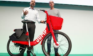 Dara Khosrowshahi (left), Uber CEO, presenting his firm's Jump e-bikes in June in Berlin – the first European city where the service will be operate.