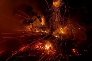 Wind blows embers as the Cave wildfire burns a hillside in Santa Barbara, California.