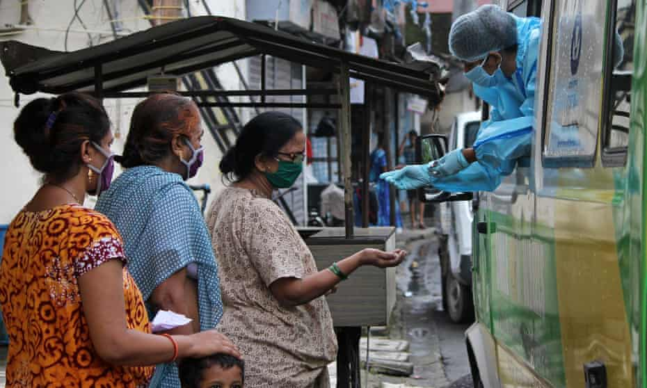 A mobile coronavirus screening van operates in Mumbai, as global cases pass 20m. India has the fastest growing infection numbers, recording more than 400,000 new case in the past week.