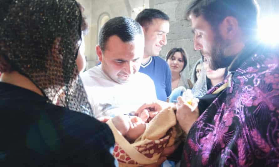 A baby is baptised in the Armenian Apostolic church in Goris, Armenia.