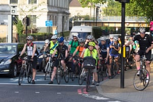 Commuters cycle home during rush hour