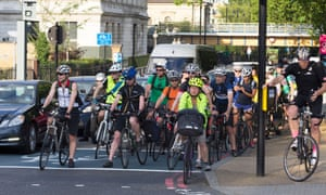 Rush-hour cyclists on Chelsea Embankment