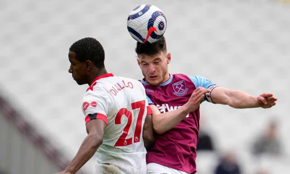 West Ham's Declan Rice wins a header with Southampton's Ibrahima Diallo in the Premier League in May.