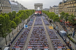 People watch a free outdoor movie at the Champs Elysees