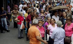 People queueing to buy food are prey for thieves in Caracas, capital of Venezuela.