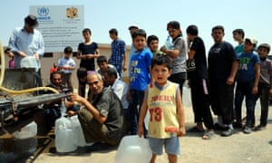 Syrians queue for water at a shelter in Hirjalleh, a rural area near the capital Damascus.
