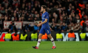 Marcos Alonso walks off after being shown the red card.