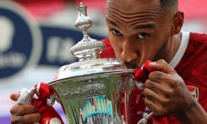 Arsenal striker Pierre-Emerick Aubameyang kisses the FA Cup.