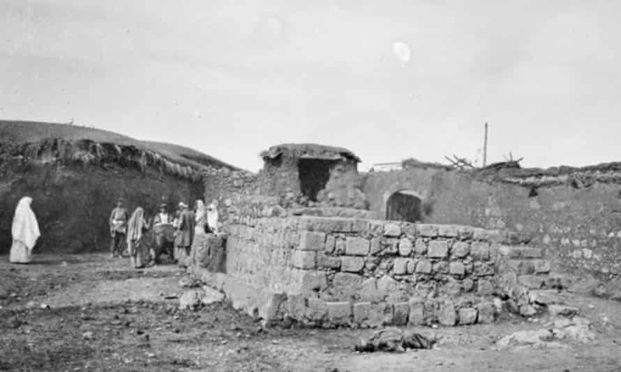 Surafend, Palestine circa 1918. An Australian soldier with some locals inside the ruins of an ancient building site.