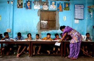 Shanaz Begum teaches destitute children at a dedicated night school in the Darapara slum in Kolkata, eastern India