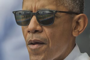 The field reflected in the sunglass of President Barack Obama.