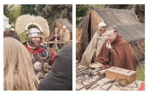 A Roman soldier talks to some of the visitors to his camp; re-enactors tuck into a pork stew