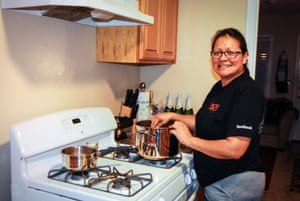 Karla Peralta, who works at the cafeteria in Facebook, demonstrates in her kitchen at home how she cooks with ingredients she picks up from the food bank.