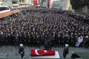 Sinop, TurkeyPeople attend the funeral of Hakan Tanrikulu, one of 31 police officers who was killed along with seven civilians in two separate bomb attacks in Istanbul on Saturday