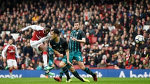 Danny Welbeck scores Arsenal's second goal, his first of two as The Gunners fight to win 3-2 against Southampton at the Emirates Stadium.