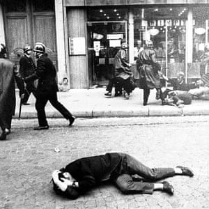 A demonstrator lies on the ground during clashes with police in Paris in this May 1968 file photo.