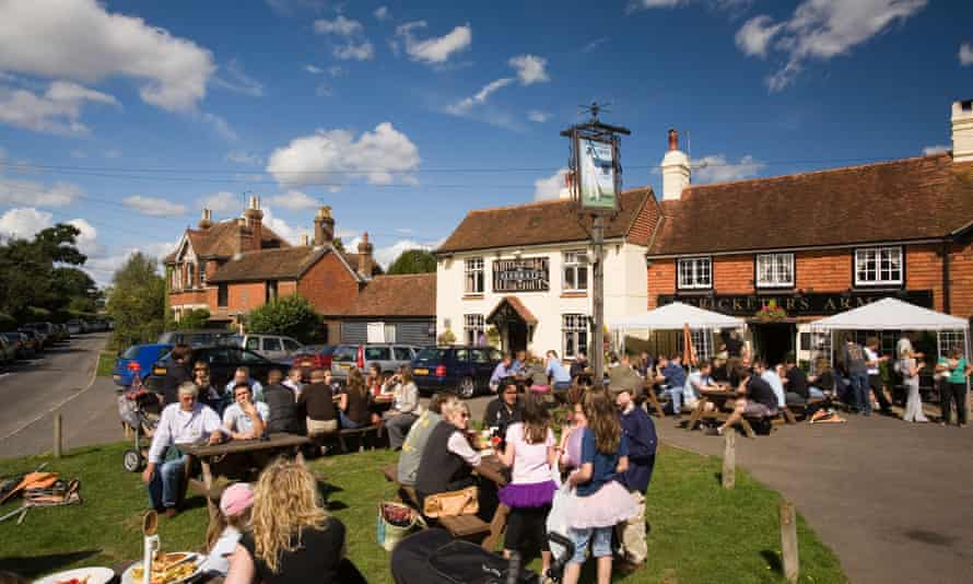 UK West Sussex Wisborough Green drinkers outside The Cricketers Village Pub