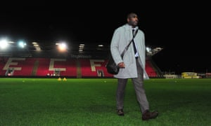 Sol Campbell surveys the scene at Exeter City, where he watched his new team, Macclesfield Town, win 1-0.