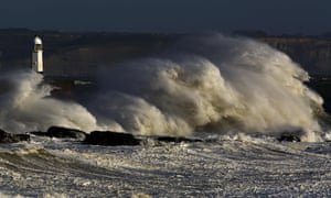 Huge waves strike the harbour wall and lighthouse at Porthcawl, south Wales, on 16 October.
